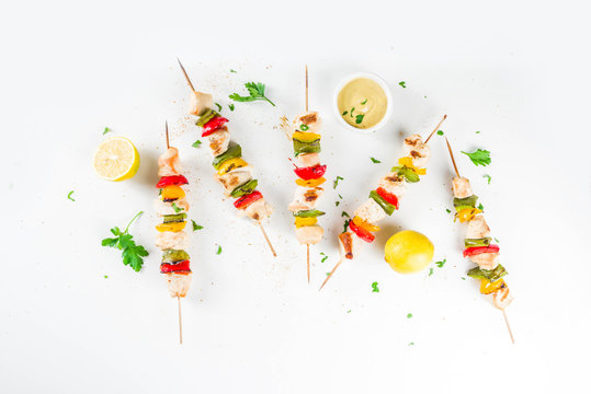 Homemade chicken meat skewers with vegetables, top view copy space