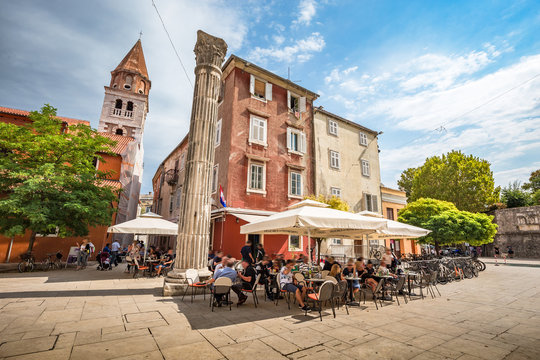 Beautiful panoramic view of idyllic scenery in the ancient roman city center of Zadar with historic church of St. Simeon on a beautiful sunny day with blue sky and clouds in summer, Dalmatia, Croatia