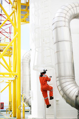 operator recording operation of oil and gas process at oil and rig plant, offshore oil and gas industry, offshore oil and rig in the sea, operator monitor production process, routine daily record