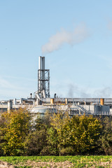 oil or gas refinery smoking chimney