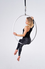 Slim and flexible Girl In An aerial hoop isolated On A White Background