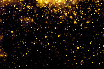 golden glitter bokeh lighting texture Blurred abstract background for birthday, anniversary, wedding, new year eve or Christmas