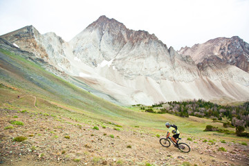 A man descends some steep switchbacks while mountain biking on the Chamberlain Trail to the top of the 10,000 foot Castle Divide in the White Cloud Mountains in Idaho.