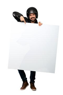 Biker man  holding an empty placard