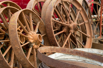 Large pile of rusted wagon wheels