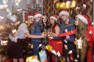 Group of people with champagne celebrating new year