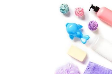 Flat lay photography baby care cosmetics. Shampoo, liquid soap and toy