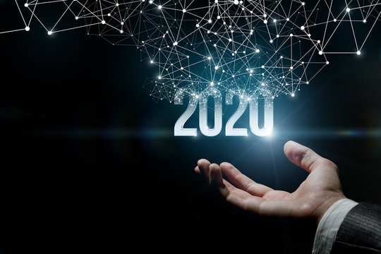 The hand shows the numbers 2020 .