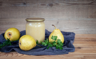 Home preservation: mashed pears in glass jars.