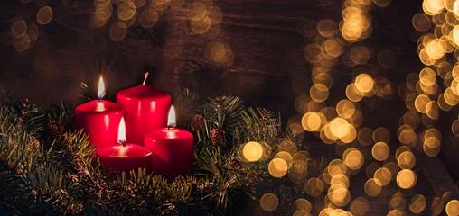 Three Advent burning candles, christmas decoration, postcard concept