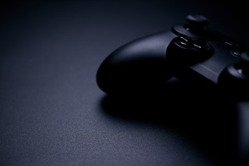 video game controller isolated on black background