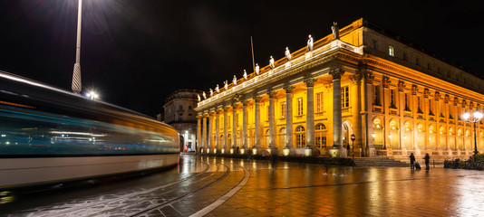 Tram passing the Grand Théâtre de Bordeaux at night in New Aquitaine, France