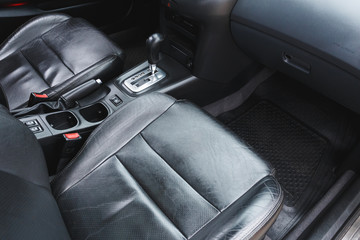 Car interior, part of front seats, close