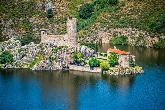 Ruines of the old castle and medieval chapel in the Grangent island. Gorges de la Loire, Saint Etienne region, France.