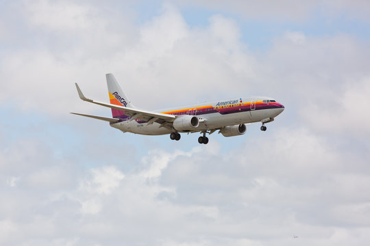 MIAMI, USA - May 19, 2017: An American Airlines Boeing 737 displaying the retro livery of Air Cal Airlines on final approach at the Miami International Airport.