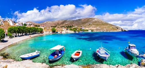 Fototapete - Amazing Greece  - Kalymnos island, charming Vlichadia village and beach with crystal sea.
