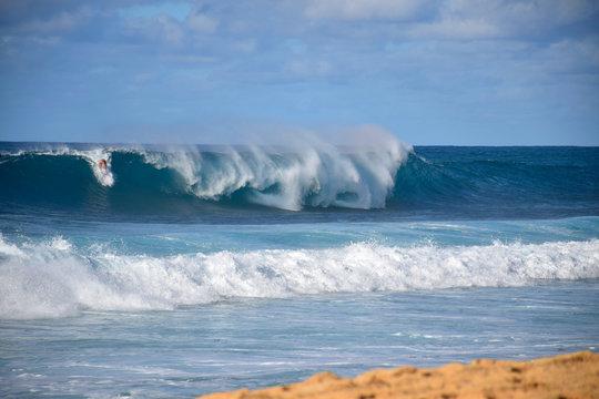 3/10: Hawaiian Surfer Taking on a Massive Rainbow Wave at the Banzai Pipeline, Oahu, Hawaii
