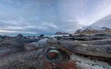The Dragons Eye is a unique natural rock formation at Uttakleiv Beach, Lofoten Islands, Norway, Scandinavia