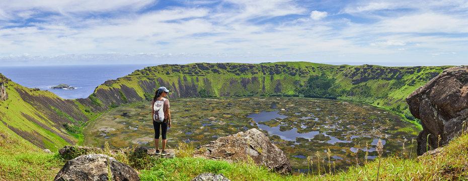 Young woman on the edge of the Ranu Kao volcano on Easter Island. Chile