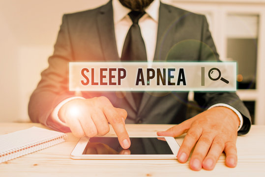 Conceptual hand writing showing Sleep Apnea. Concept meaning disorder which demonstrating repeatedly stop breathing when asleep Male human wear formal clothes present use hitech smartphone