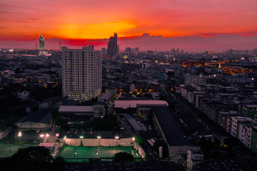 Fotobehang Bangkok panoramic high-angle evening background of the city view,with natural beauty and blurred sunsets in the evening and the wind blowing all the time,showing the distribution of city center accommodation