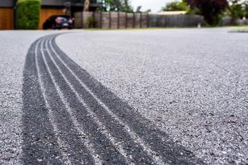 Tyre track on asphalt from hard braking - shallow focus