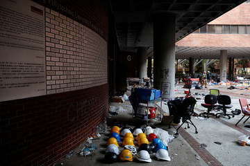 Helmets of protesters are left behind in Hong Kong Polytechnic University (PolyU) in Hong Kong