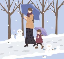 冬 散歩する親子