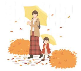 秋 紅葉の中で散歩する親子