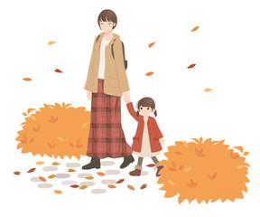秋 手をつないで散歩する親子