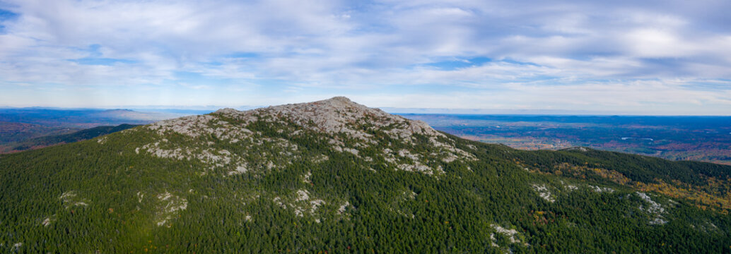 Aerial panoramic view of rocky Mount Monadnock summit during fall day