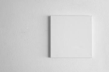 Fototapeta single  white rectangular canvas frame on cement wall background