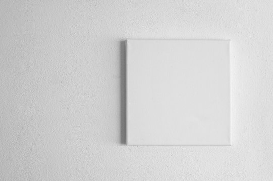 single  white rectangular canvas frame on cement wall background