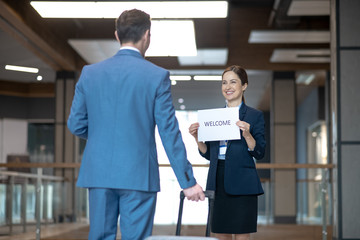 Pleasant business lady meeting her business partner in the airport