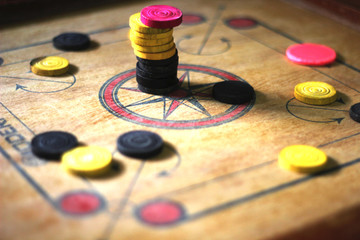 A game of carrom with pieces carrom man on the board carom - stacking.A game of carom set and ready to play