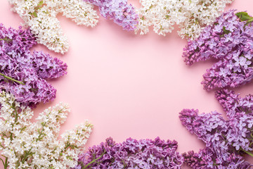 Wall Murals Lilac Branches of lilac on pink background. White and purple lilac. Romantic spring mood. Top view. Copy for your text - Image