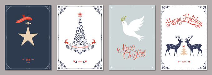 Wall Mural - Elegant vertical winter holidays greeting cards with New Year tree, dove, deers, Christmas ornaments and ornate typographic design.