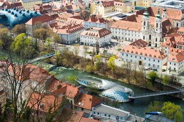 View at Graz City - Murinsel Bridge, city rooftops nad Mur river.