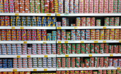 SEREMBAN, MALAYSIA -OCTOBER 3, 2018: Tuna fish fillet in metal can and displayed for sale on shelves in the supermarket. Its comes in variety taste and flavors.