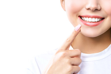 Perfect healthy teeth smile of a young woman. Teeth whitening. Dental clinic patient. Image symbolizes oral care dentistry, stomatology. Isolate en white backround.