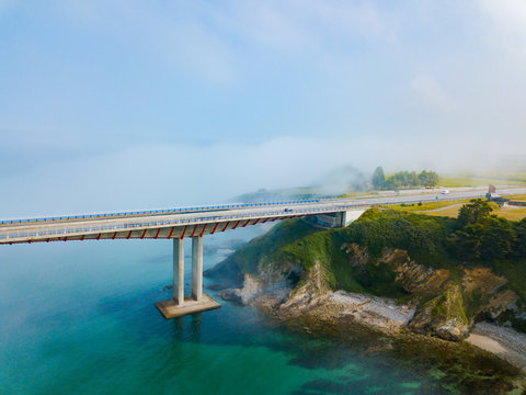 Aerial view on dos Santos bridge during fog and bay. Near Ribadeo in Northern Spain