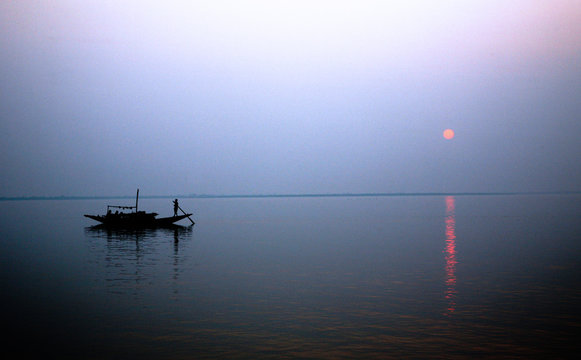 A stunning sunset looking over the holiest of rivers in India. Ganges delta in Sundarbans, West Bengal, India.