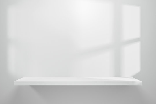 Front view of empty shelf on white table showcase and wall background with natural window light. Display of backdrop shelves for showing minimal concept. Realistic 3D render.