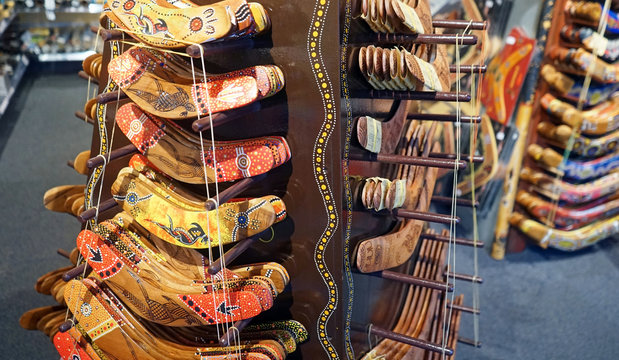 Aboriginal hand painted boomerangs stacked for display