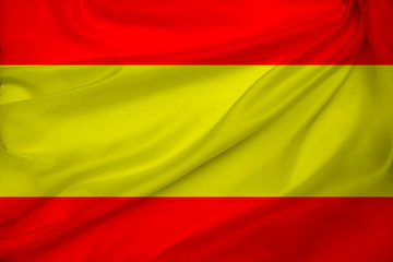 photo of the beautiful colored national flag of the modern state of Spain on a textured fabric, concept of tourism, economics and politics, closeup