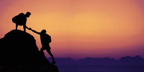 Climbers on a mountain peak with copy space - fototapety na wymiar