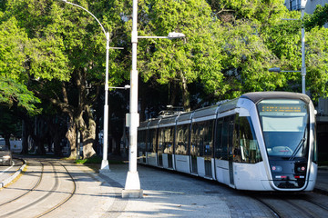 A light electric train in Rio de Janeiro downtown going to Santos Dumont airport, Brazil Fotomurales
