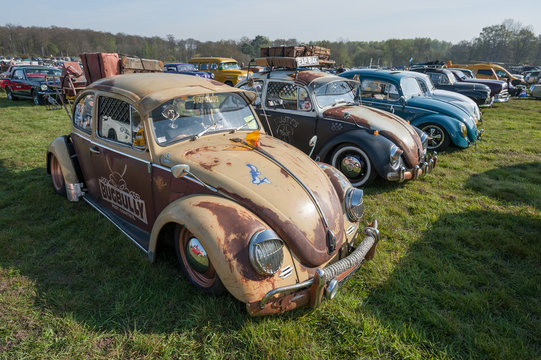 Line of vintage Beetle cars at a meeting of classic vehicles in Rushmoor, UK - April 19, 2019