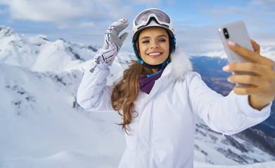 Girl Makes A Selfie In Ski Clothing On Snow Mountain.