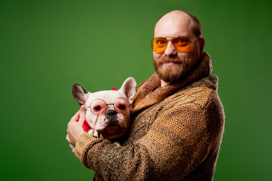 Man with french bulldog in his arms